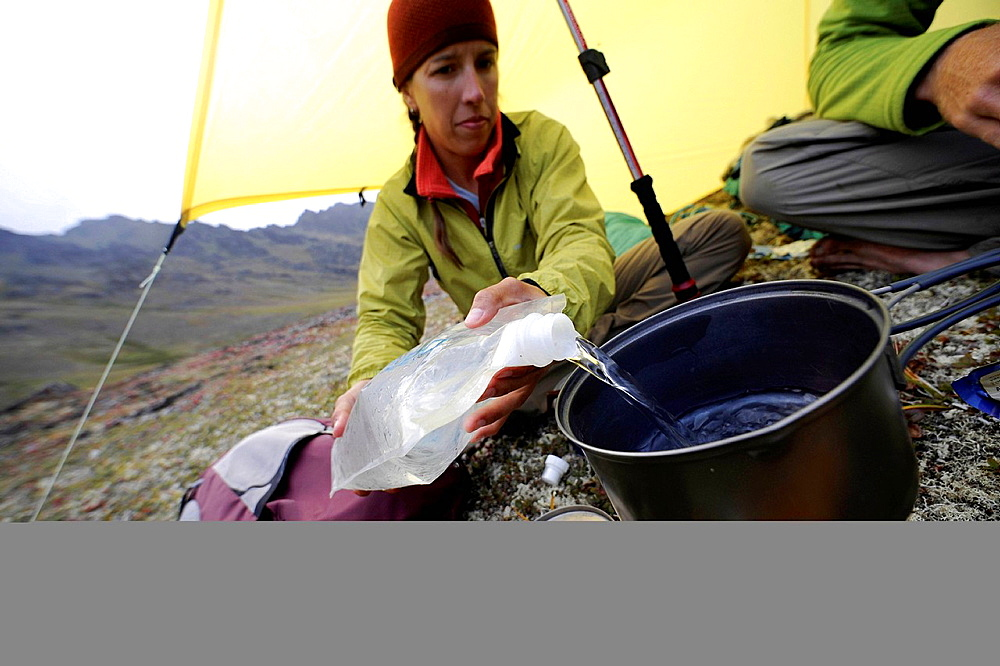 Hiker preparing food