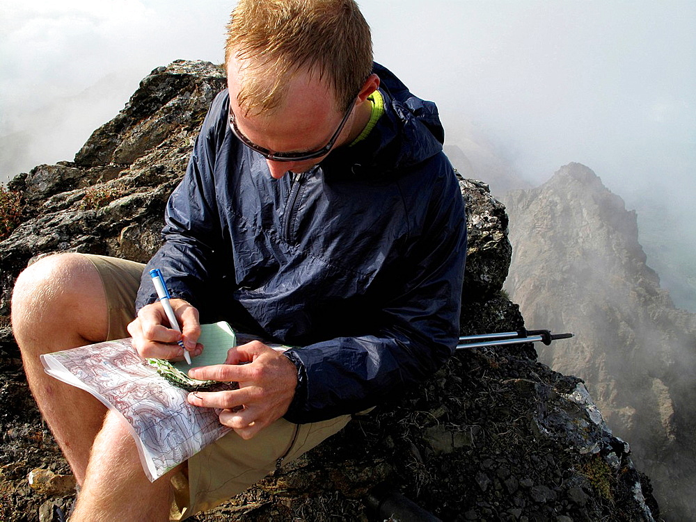 Hiker writing notes