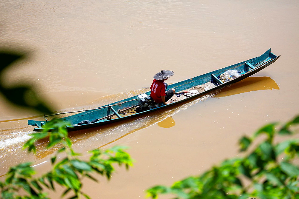 Lao fisheman on the Nam Khan river in Luang Prabang, Laos.