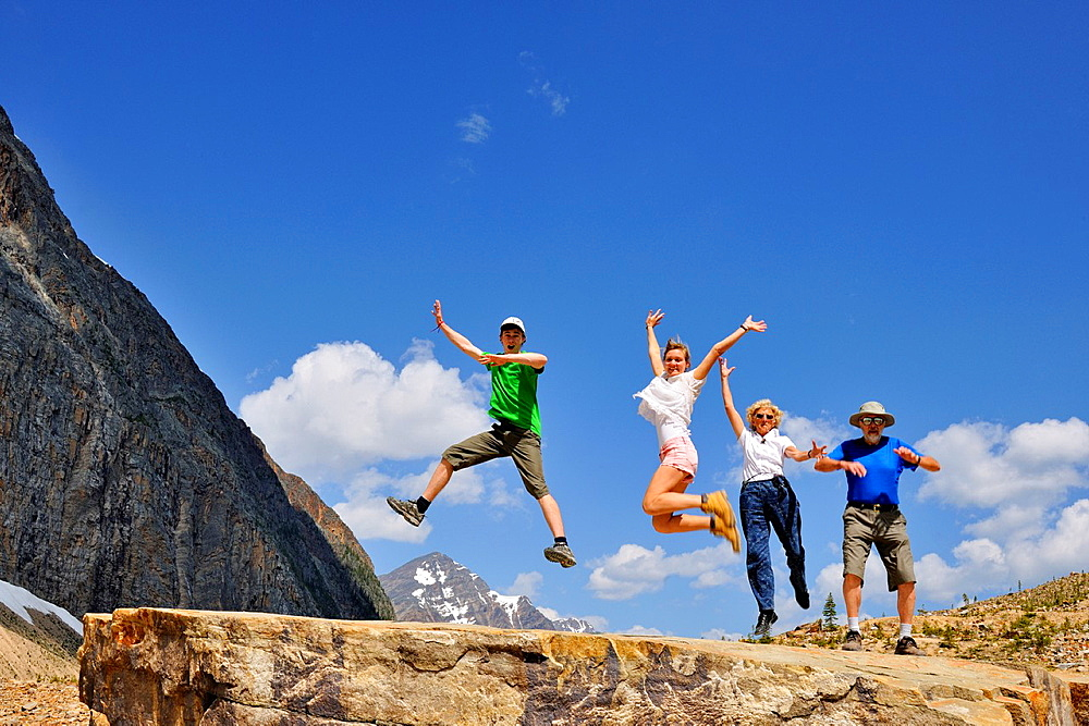 Tourists frolicking below Mt. Edith Cavell, Jasper National Park, Alberta, Canada.