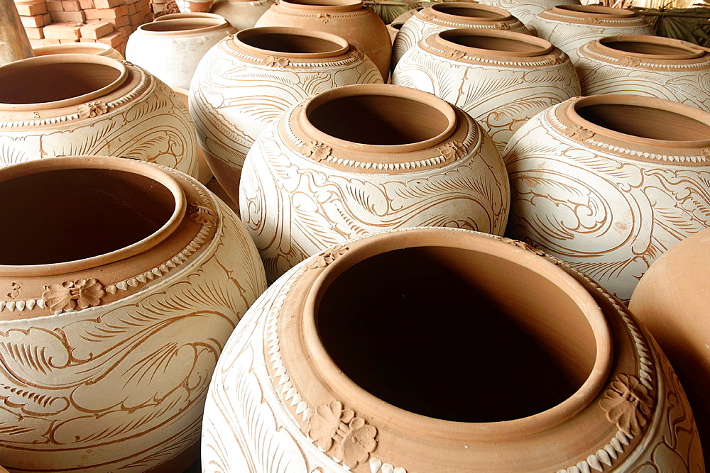 Nwe Nyein is a town of pottery  Almost all the inhabitants earn their living by making various designs of pot  Along the Irrawady river  Mandalay Division  Burma  Republic of the Union of Myanmar.