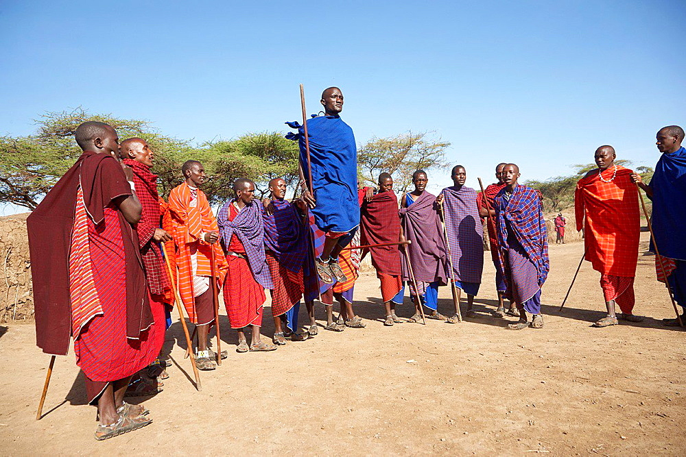 A group of Maasai men doing a traditional dance. Serengeti. Tanzania.