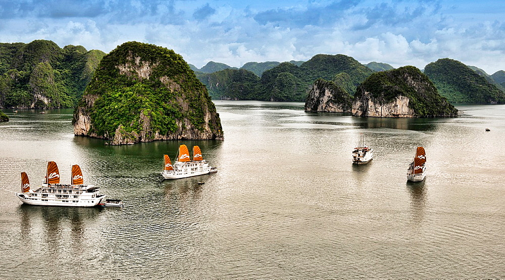 traditional junks sailing in Halong Bay, Vietnam.