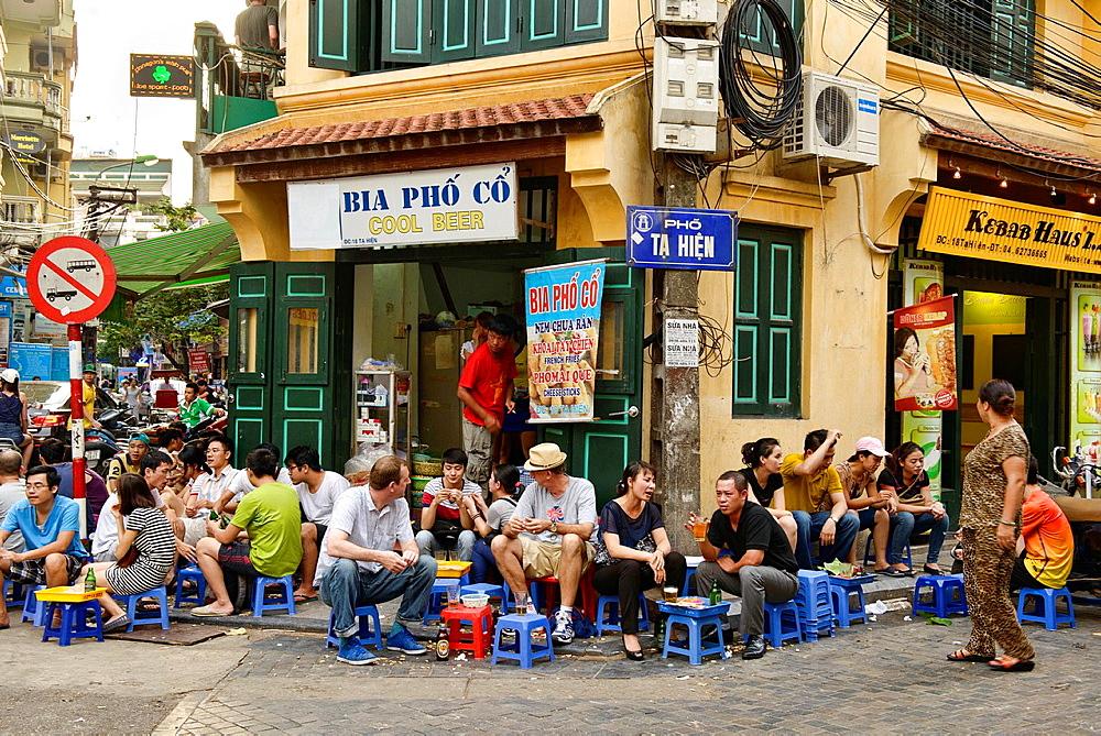 enjoying draft beer on the Bia Hoi Corner in Hanoi, Vietnam.