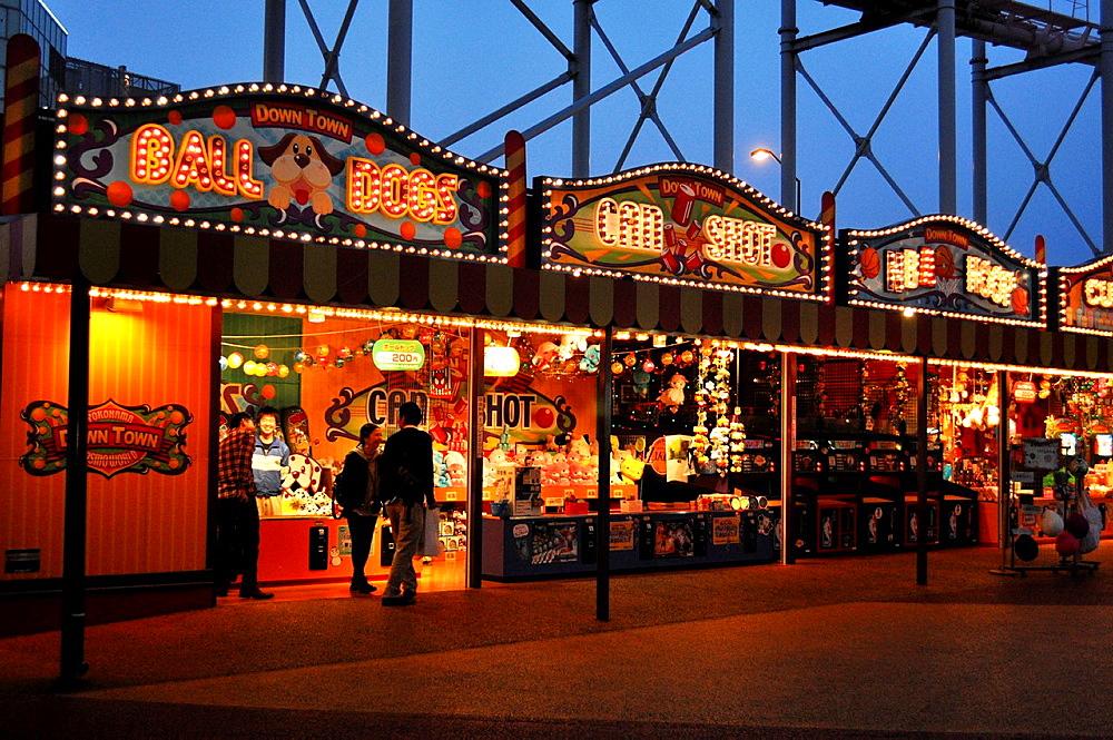 Yokohama, Japan, Cosmo World amusement park at dusk in Minato Mirai