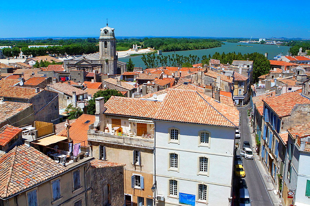 Arles town and Rhone river view from roman amphitheatre or roman arenas, monument declarated World Heritage by UNESCO, in Arles, Bouches-du-Rhone department, in Provence-Alpes-Cote d'Azur, France.