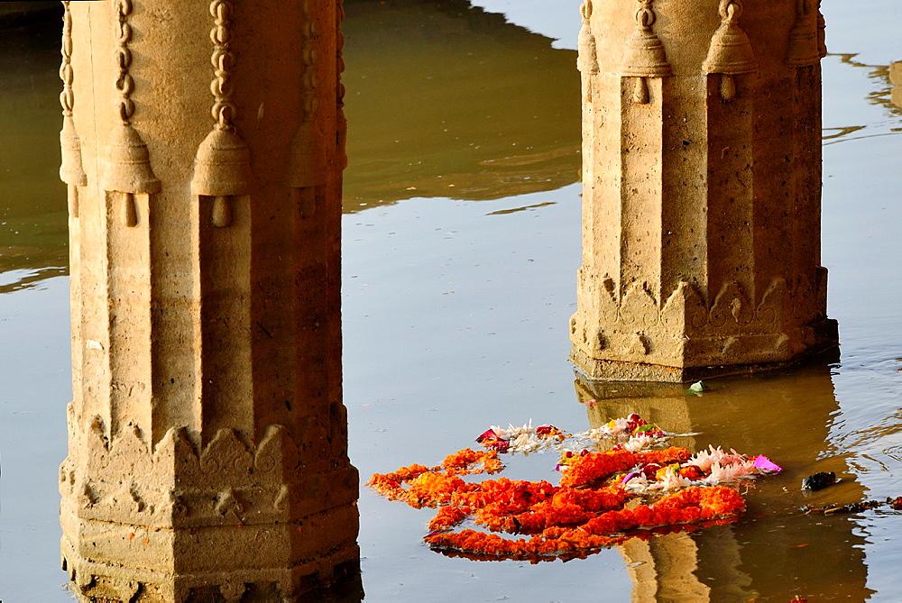 India, Uttar Pradesh, Varanasi, Sunken temple, Marygold garland.