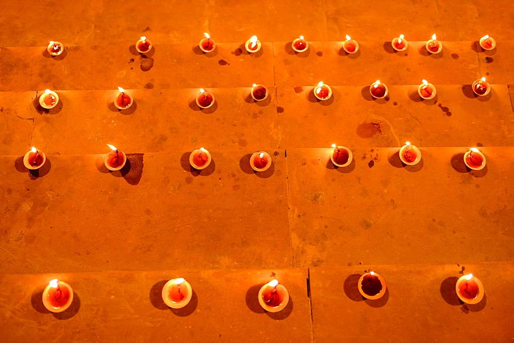 India, Uttar Pradesh, Varanasi, Dev Deepawali festival, Earthen lamps lit on the stairs leading to the Ganges.