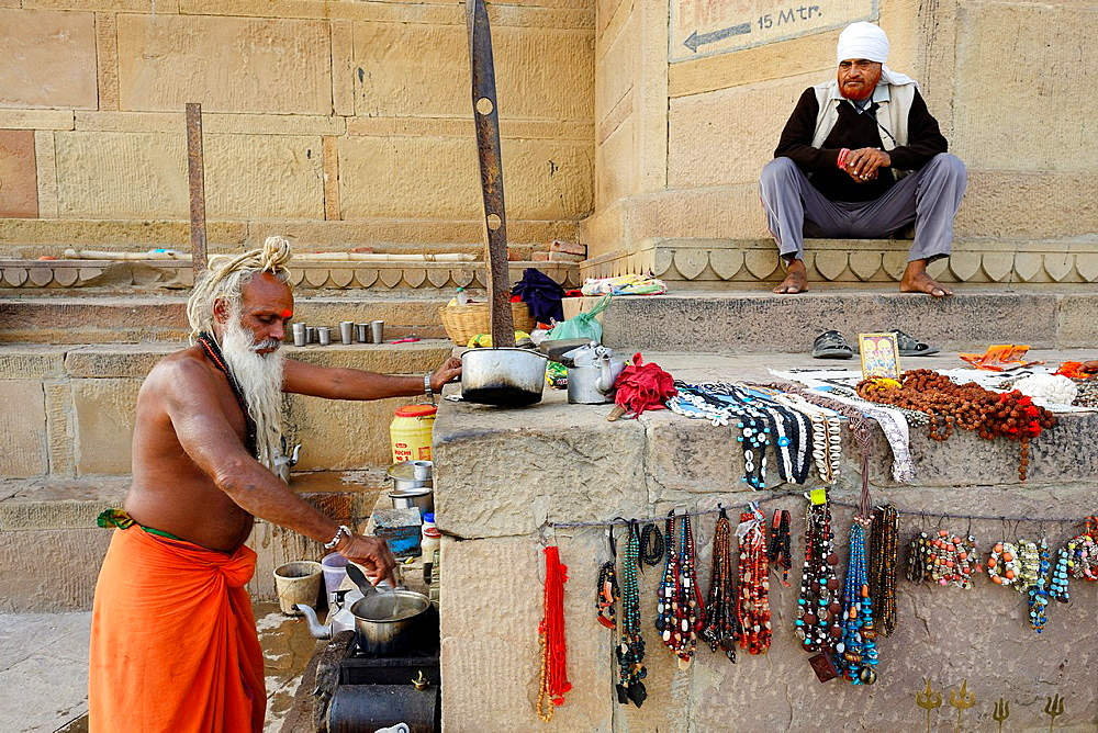 "India, Uttar Pradesh, Varanasi, ""Chai Baba"", Sadhu (ascetic) making a living in preparing tea for the passer bys."