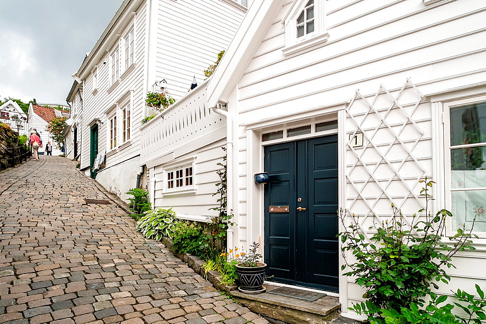 A cobbled street leading through the beautiful old town part of Stavanger in Norway.