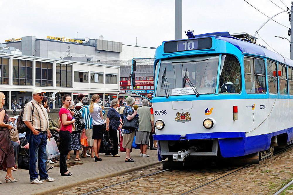 tramway in front of the Central Market that is one of the largest and oldest markets in Europe with five food pavillons located inside vast converted Zeppelin hangars, Riga, Latvia, Baltic region, Northern Europe.