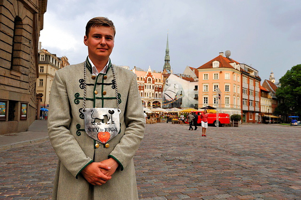 young man working for the restaurant Key to Riga on Dome Square, Old Town, Riga, Latvia, Baltic region, Northern Europe.