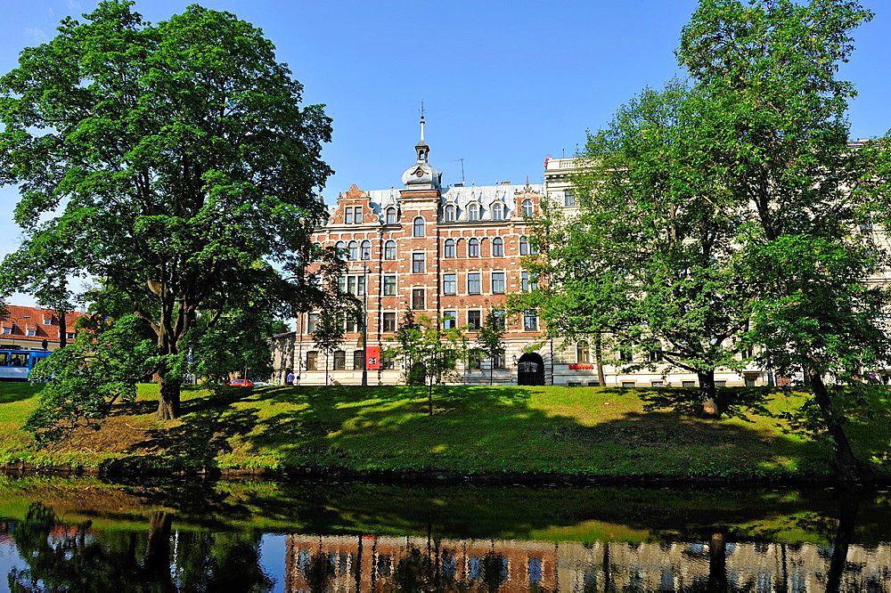 banks of the Canal Pilsetas surrounding the Old Town of Riga, Latvia, Baltic region, Northern Europe.