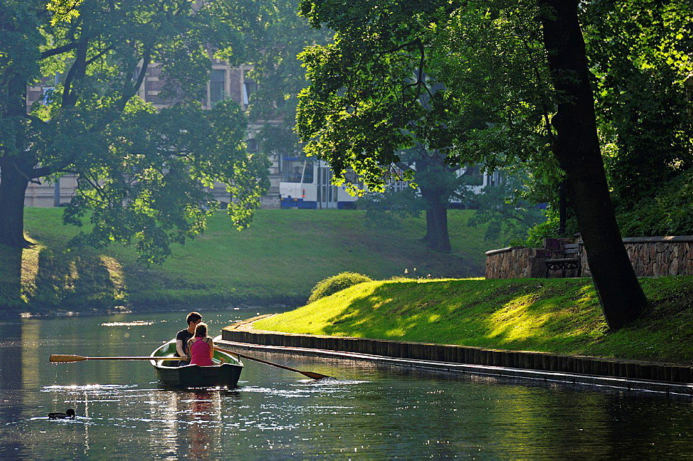 rowing on the the Pilsetas Canal surrounding the Old Town of Riga, Latvia, Baltic region, Northern Europe