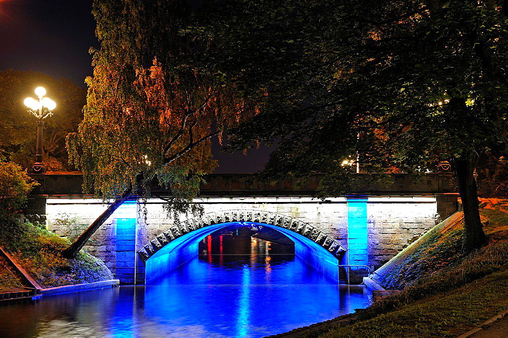 floodlit Brividas bridge over the Canal surrounding the Old Town of Riga, Latvia, Baltic region, Northern Europe