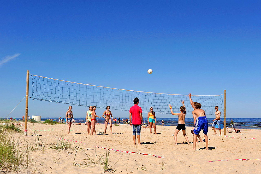 teenagers playing beach-volley, Jurmala, Gulf of Riga, Latvia, Baltic region, Northern Europe.