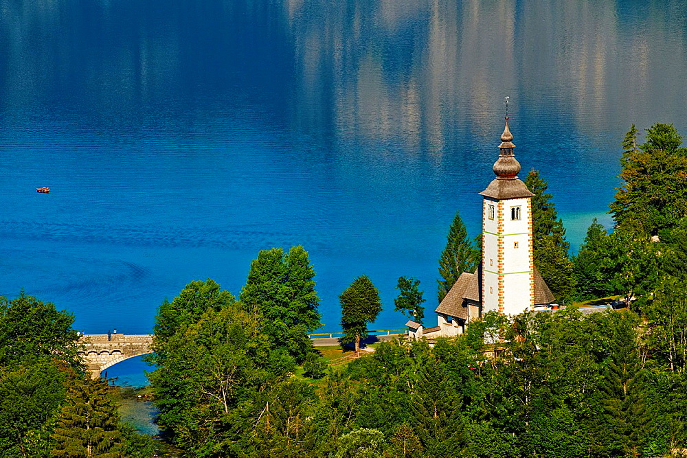 Slovenia, Gorenjska region, Triglav National Park, Bohinj lake and Church of St. John the Baptist.