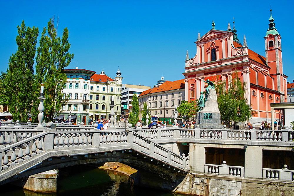 Slovenia, Ljubljana, Franciscan church and the Triple Bridge.