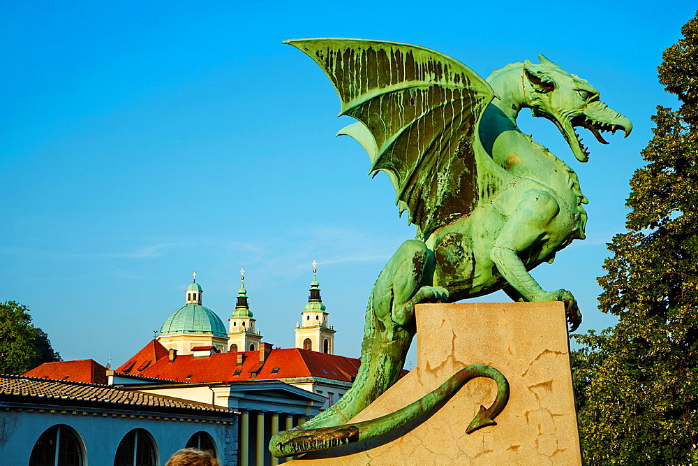 Slovenia, Ljubljana, Dragon Bridge and St Nicholas church.