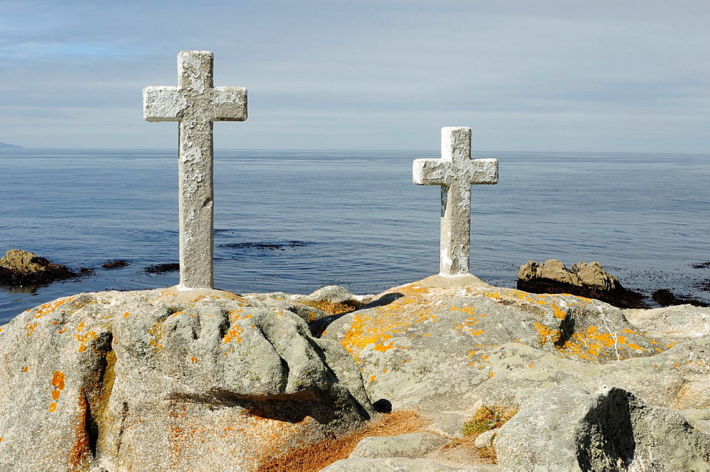 The crosses in memory to the fishers passed away while collecting the goose barnacles that do occur on the coastal rocks. Punta Roncudo, Galicia.