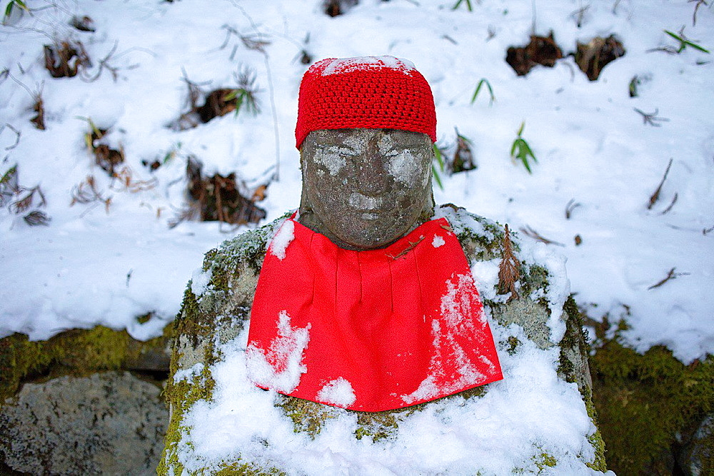 Narabijizo, Bakejizo, jizo stone statue,buddhist guardian deity,one of the 70 statues lined up in Kanmangafuchi Abyss, Nikko, Japan.