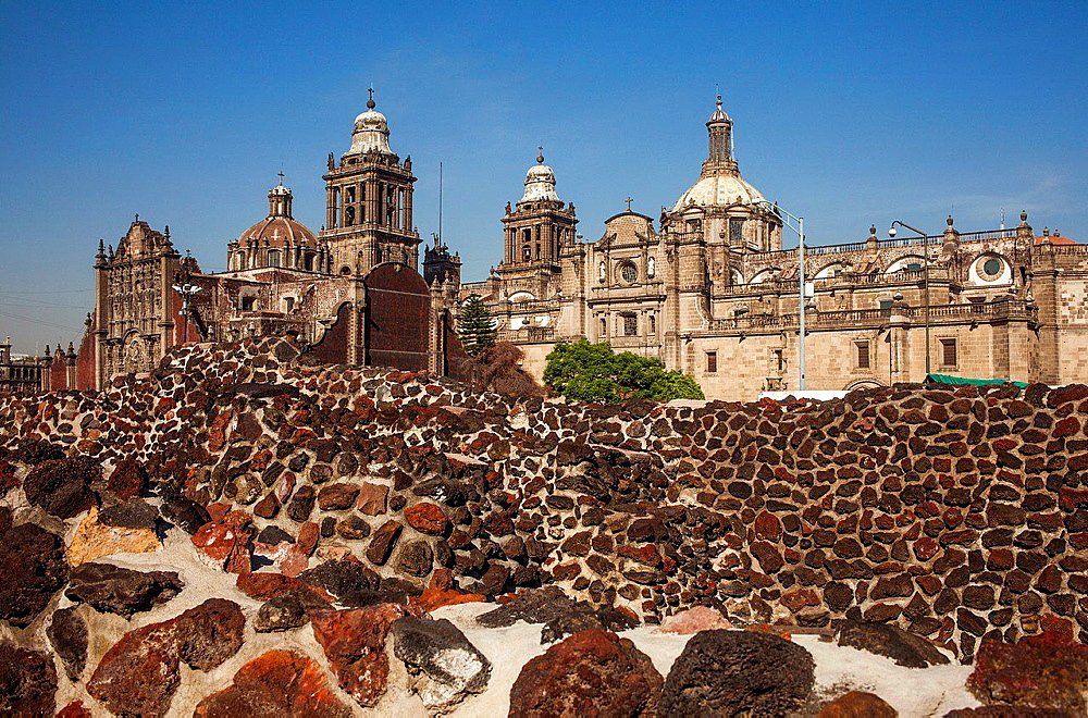 The Aztecs Ruins of Templo Mayor, Archaeological Site, in backgroubd The Metropolitan Cathedral, historic center, Mexico City, Mexico.