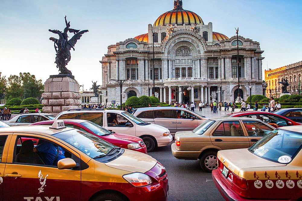 Traffic and Palacio de Bellas Artes, Mexico City, Mexico.