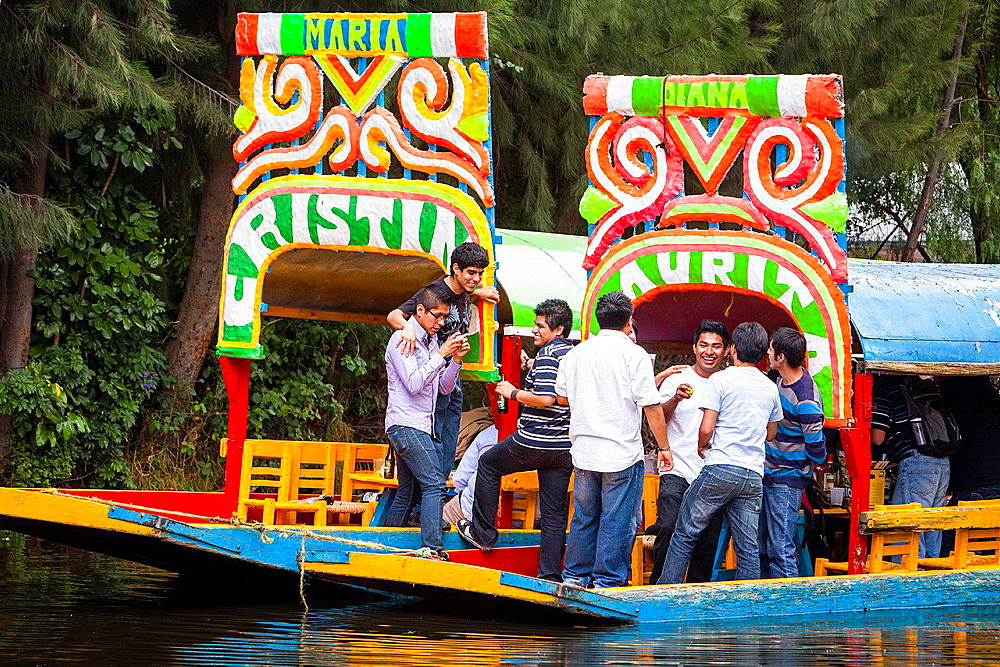 Trajineras on Canal, Xochimilco, Mexico City, Mexico.
