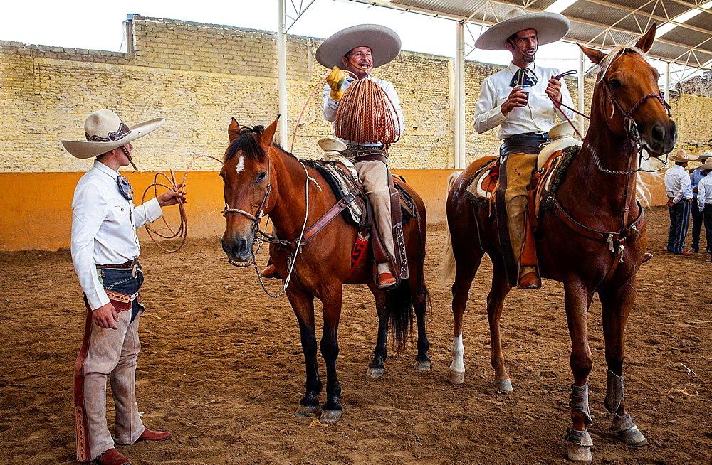 Mexican charros. A charreada Mexican rodeo at the Lienzo Charro Zermeno, Guadalajara, Jalisco, Mexico.