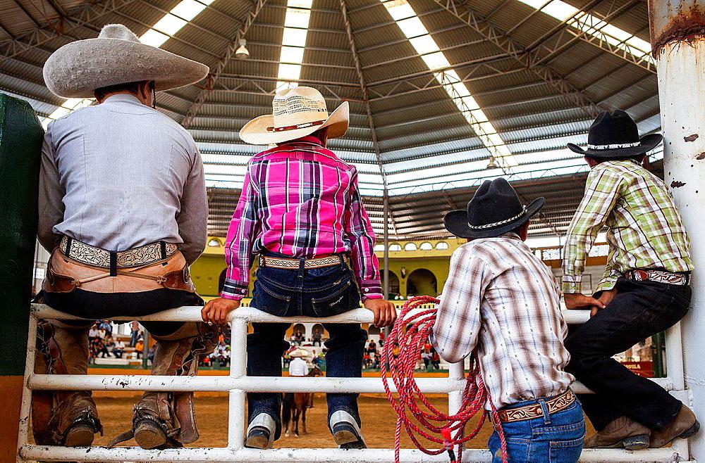 Spectators watch a charreada Mexican rodeo at the Lienzo Charro Zermeno, Guadalajara, Jalisco, Mexico.