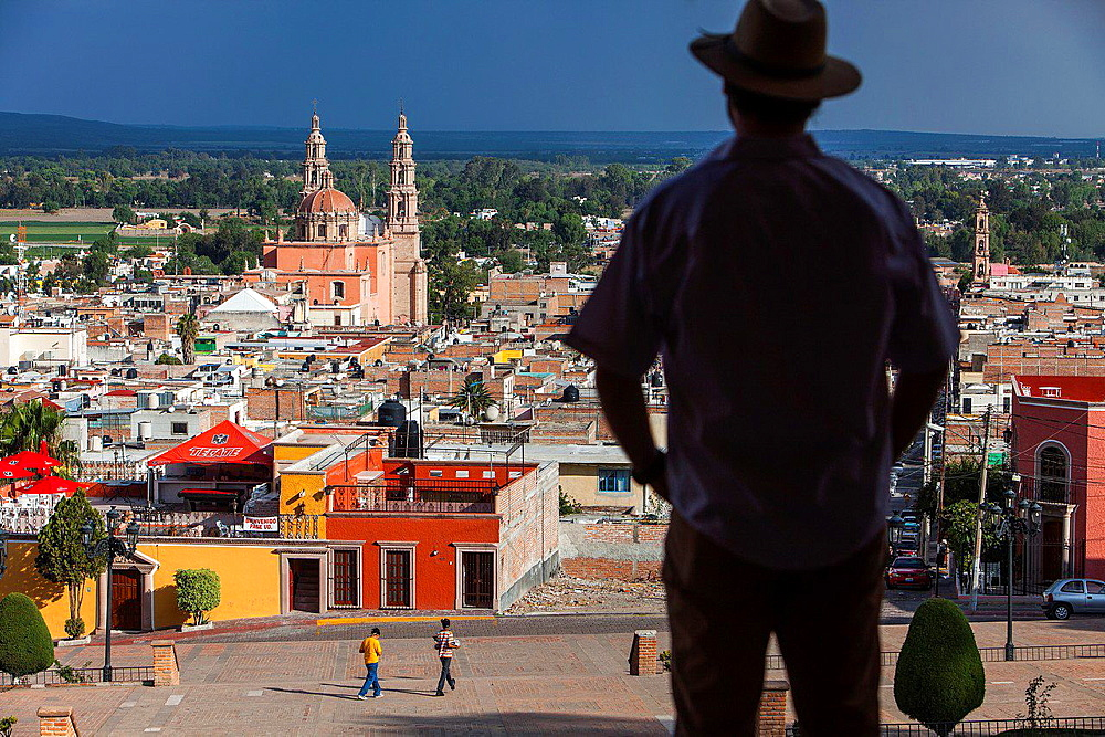 View from 'El Calvario'. Man, in background Parroquia de la Asuncion de Maria, Lagos de Moreno, Jalisco, Mexico. - 817-455991