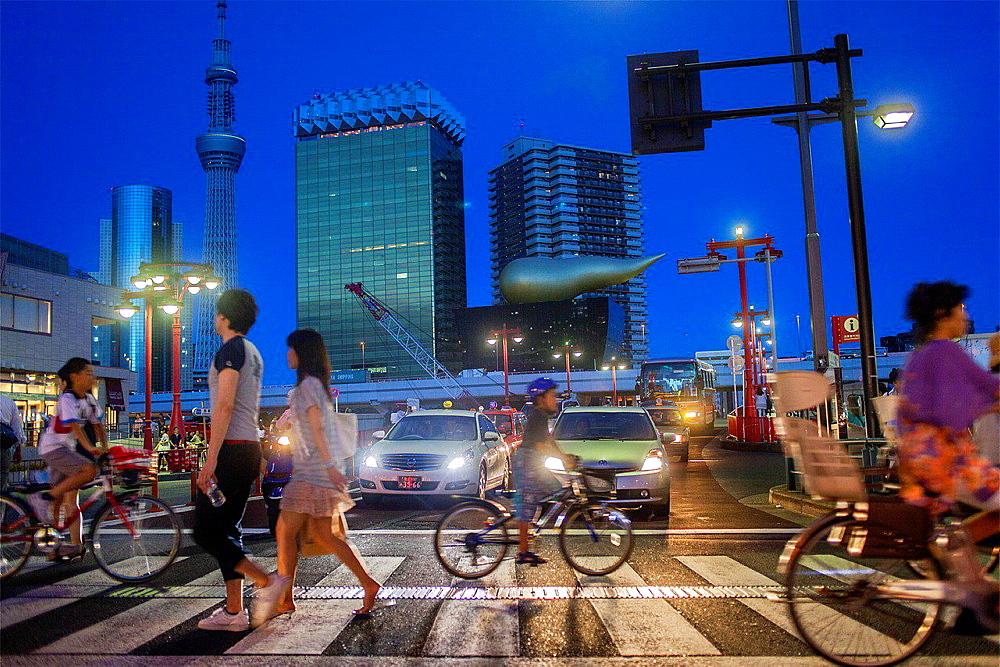 Crosswalk in Kaminarimon street, in background Sky Tree and Asahi building, Asakusa District, Tokyo, Japan.