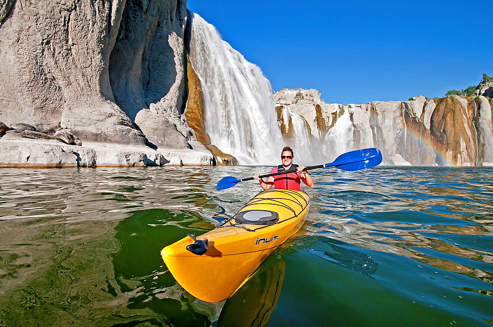 paddling a kayak below Shoshone Falls on the Snake River in the Snake River Canyon near the city of Twin Falls in southern Idaho.