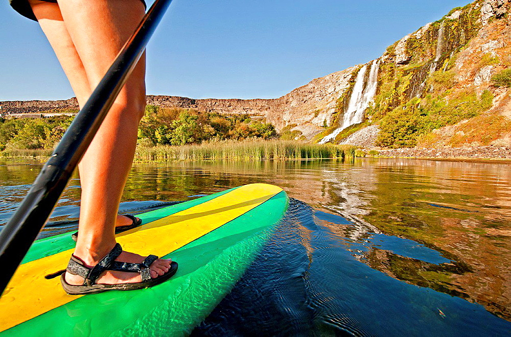 riding the Standup Paddle Board at Thousand Springs in the Snake River Canyon near the city of Hagerman in southern Idaho.