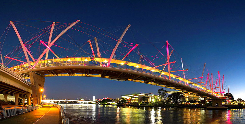 Evening view of Kurilpa Bridge crossing the Brisbane River in Brisbane Queensland Australia