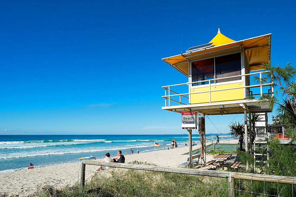 Lifeguard hut on beach at Surfers Paradise seaside town on the Gold Coast in Queensland Australia.