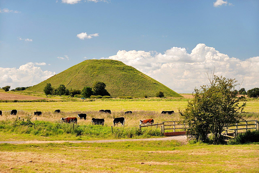 Silbury Hill artificial Neolithic prehistoric chalk mound outside village of Avebury, Wiltshire England. 4750 years old 40m high.