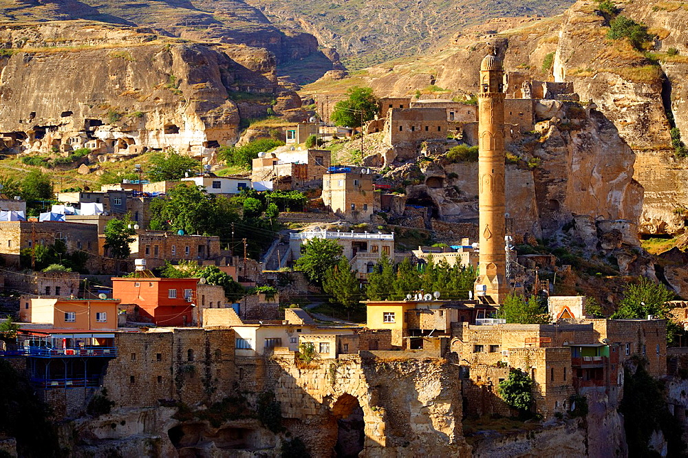 El Rizk Mosque & town of Hasankeyf. The Mosque was built in 1409 by the Ayyubid sultan Suleyman and stands on the bank of the Tigris River. It has Kufic incriptions & decorations., Turkey 10.