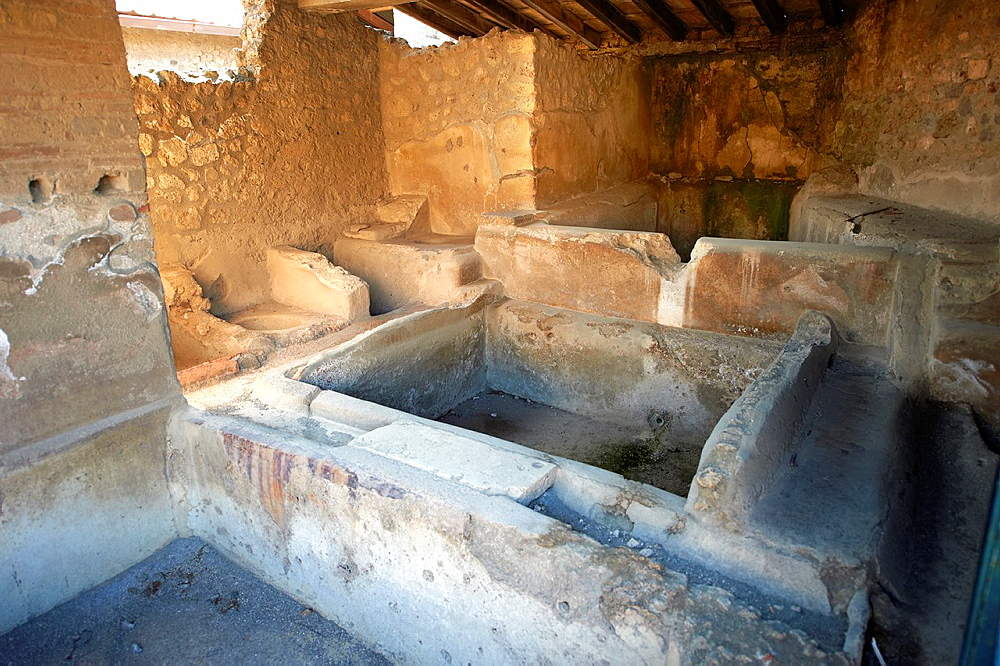 Stone dying baths of the Fullery of Stephanus on the Via del Abbondante, Pompeii. Fulleries were an important business in ancient Pompeii.† Fullers processed, dyed, and washed cloth.†.