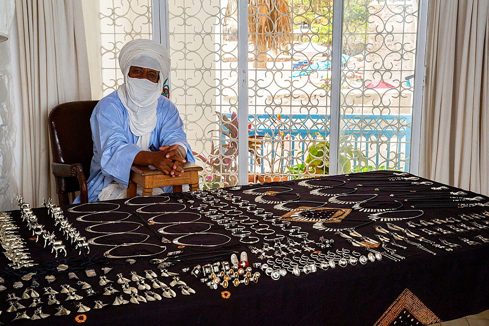 Silversmith Adam Zidia, a Tuareg from Agadez, Niger, offering Silver Jewelry at Biannual Arts Festival, Goree Island, Senegal.