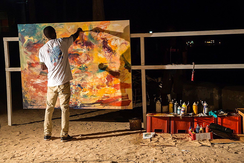 Painter Paints a Canvas During Dinner to Commemorate 10th Anniversary of Biannual Arts Festival on Goree Island, Senegal. Progress after Twenty Minutes.