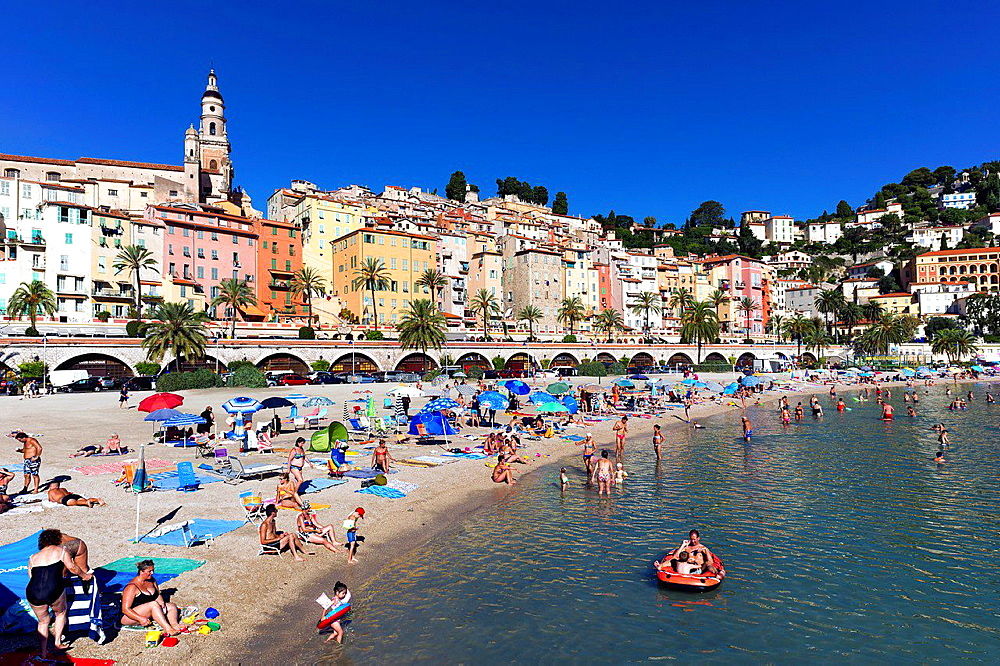Europe, France, Alpes-Maritimes, Menton. The beach in summer.