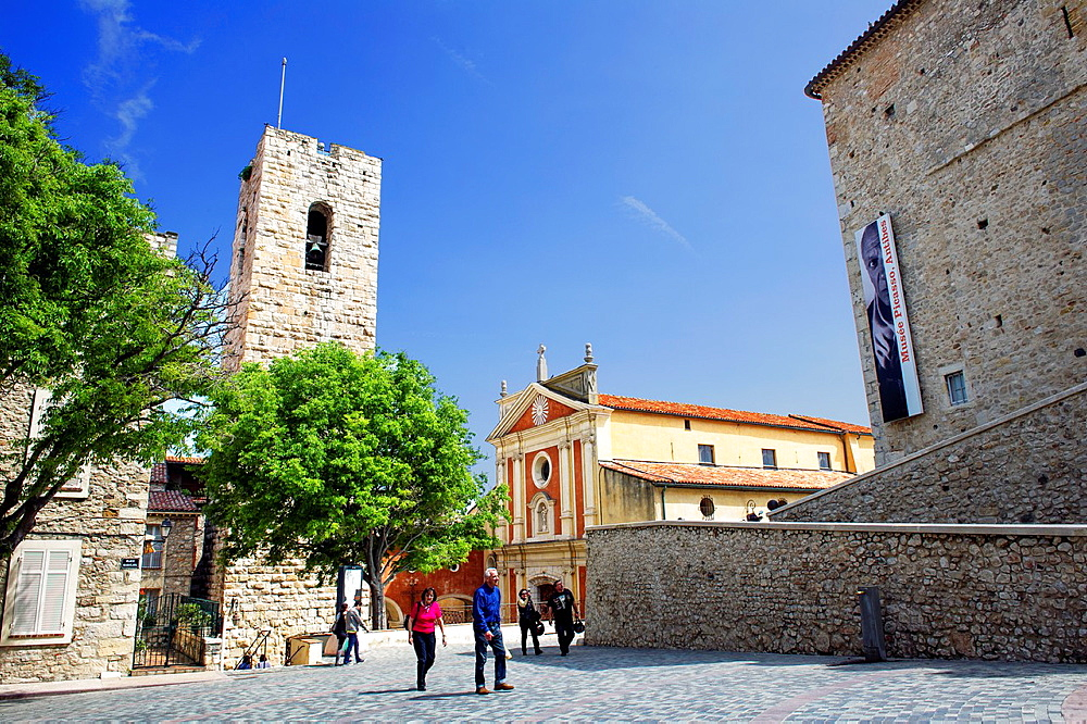 Europe, France, Alpes-Maritimes, Antibes. Place Mariejol. Picasso Museum in the Grimaldi castel and the cathedral.