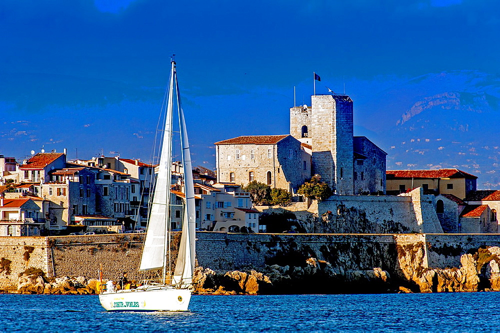 Europe, France, Alpes-Maritimes, Antibes. Sailboat front of the ramparts of the old city.