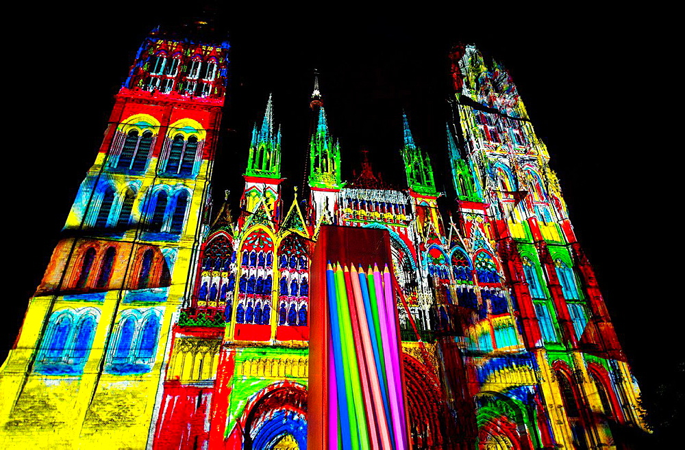 light show projected on Rouen cathedral, presentation celebrates Impressionism, Rouen is near Giverny which boasts Claude Monet's beautiful gardens, Rouen Cathedral was one of favourite Claude Monet's objects to paint, Rouen, Upper Normandy, France, Europe.