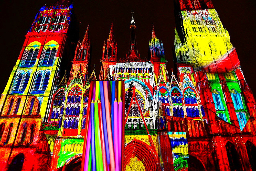 light show projected on Notre Dame Cathedral in Rouen, presentation celebrates Impressionism, Rouen is near Giverny which boasts Claude Monet's beautiful gardens, Rouen Cathedral was one of favourite Claude Monet's objects to paint, Rouen, Upper Normandy, France, Europe.