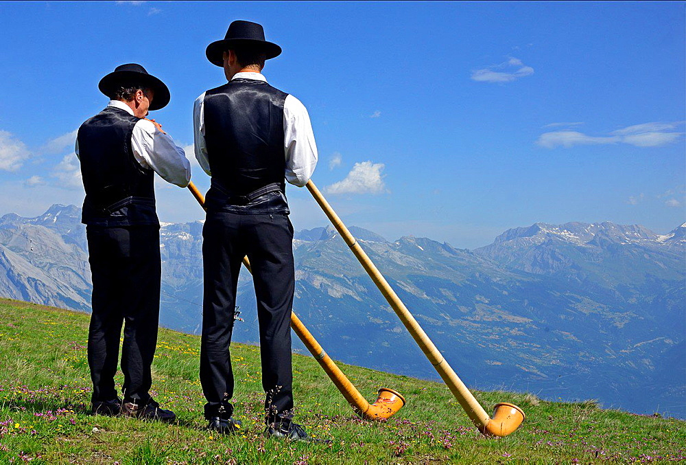Two men with alphorns, Swiss Alps, Nendaz, canton Valais, canton Wallis, Switzerland