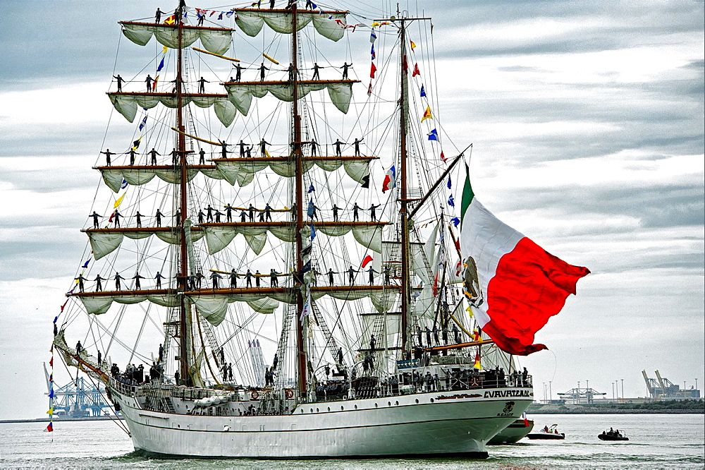 sailors on Cuauhtemoc, Mexican sailing vessel, Armada 2013, cruise of biggest sailing vessels in the world on Seine river from Rouen to Atlantic Ocean, here passing habour in Le Havre entering Atlantic Ocean, France, Europe.