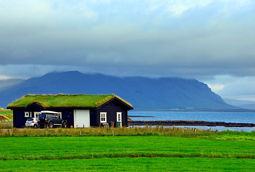 residential house with roof covered with grass near Akranes, Western regions, Iceland.