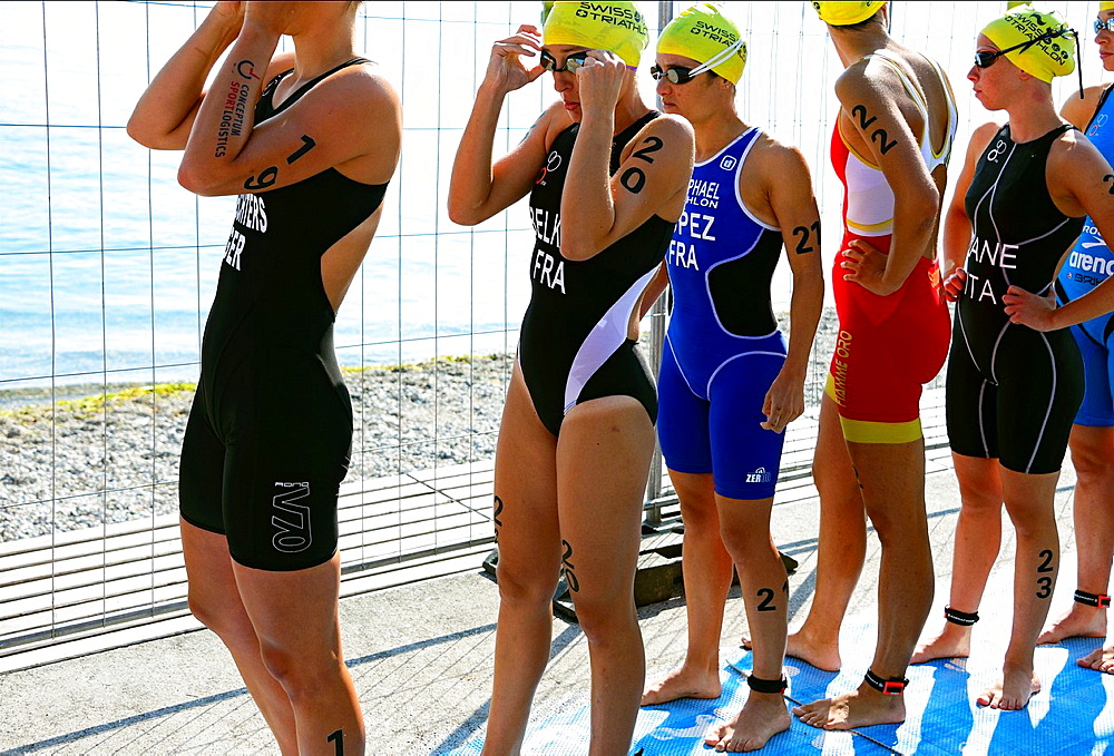 female athlets, last moments before swimming race start, 25th International Geneva Triathlon, on July 21, 2013, Geneva, Lake Geneva, Switzerland.